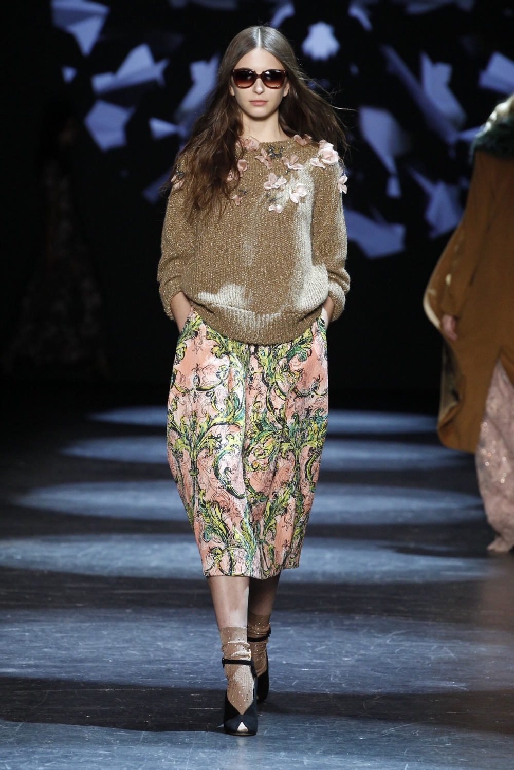 Emily Blanco displays a Monique Lhullier sweater and floral midi skirt from NYFW.