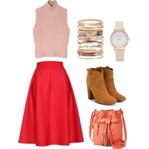 Emily Blanco pairs a pink sleeveless sweater with a red A-line midi skirt, inspired by the Pantone color Fiesta and the Indian Paintbrush wildflower.