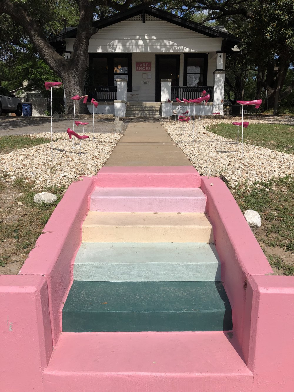 These colorful steps lead up to one of Austin's best boutiques to shop for shoes, The Art of Shoes.