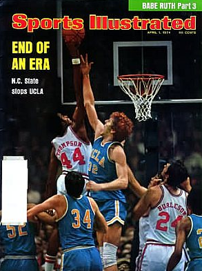 "Sports Illustrated cover showing 6' 4"" David Thompson, who won the tournaments' Most Oustanding Player, skying over 6' 11"" Bill Walton"