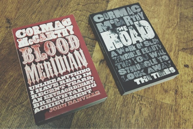 I've been meaning to read Blood Meridian for a long time, and only have the movie tie-in copy of The Road (move tie-in books are lame). So when I saw these copies with covers designed by  David Pearson , I had to get them.