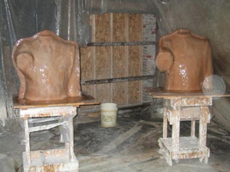 Rubber molds are painted on the clay.