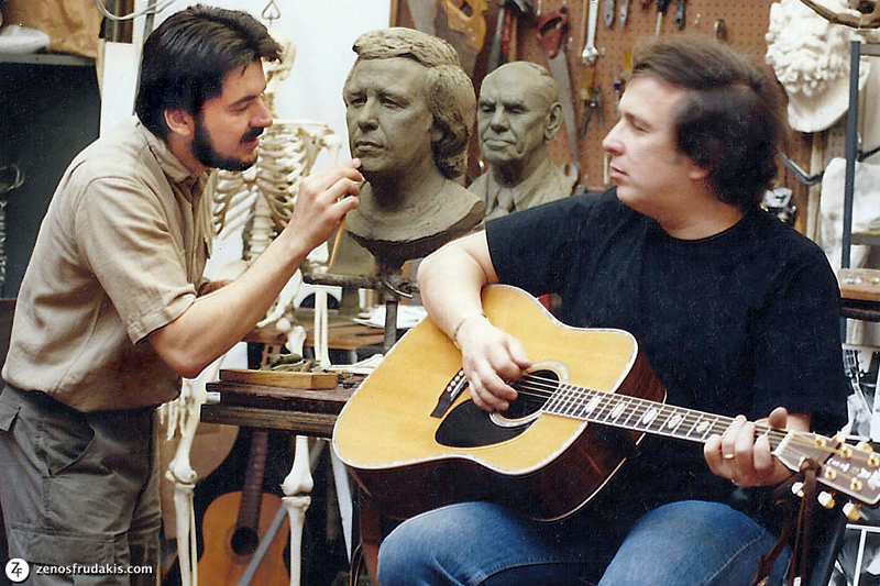 Don McLean sits with his guitar as Zenos Frudakis sculpts him.