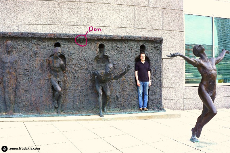 "Singer/song writer Don McLean standing in the ""Freedom"" sculpture. Sculptor Zenos Frudakis incorporated portrait of Don McLean into relief wall."