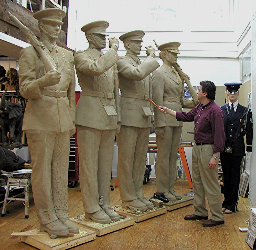 With the approval of the Board, Zenos started over, sculpting an Honor Guard sculpture eight feet high. Having had experience creating the small, intermediate and large models, the eight-foot high model developed quickly.