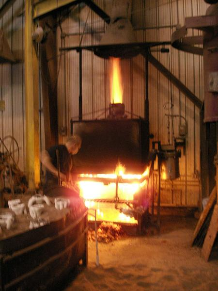 The ceramic shell was then taken out of the kiln, and molten bronze, heated to 2100 degrees Fahrenheit, was poured into it.