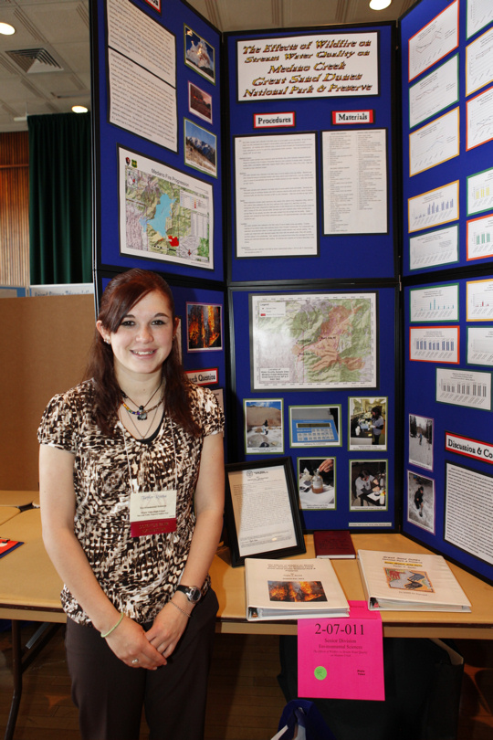 Taylor Rocha from Monte Vista High School standing in front of her project display board.