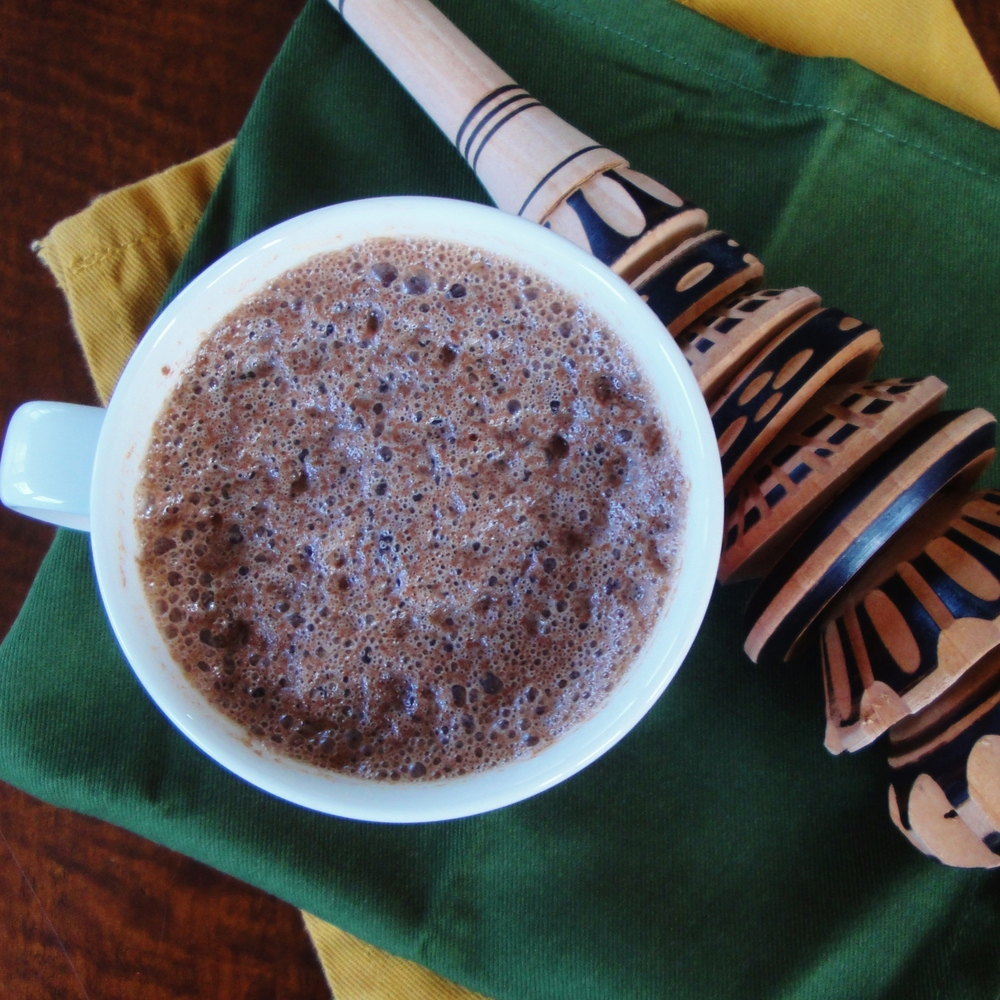 A frothy cup of Homemade Mexican Hot Chocolate made in the Adventure Kitchen in April 2015 (shown with a molinillo).
