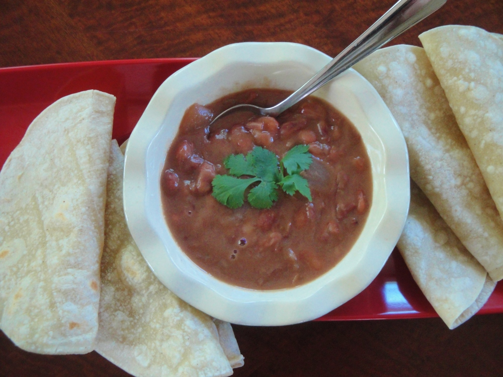 Frijoles de la Olla made in the Adventure Kitchen, served with warm corn tortillas.