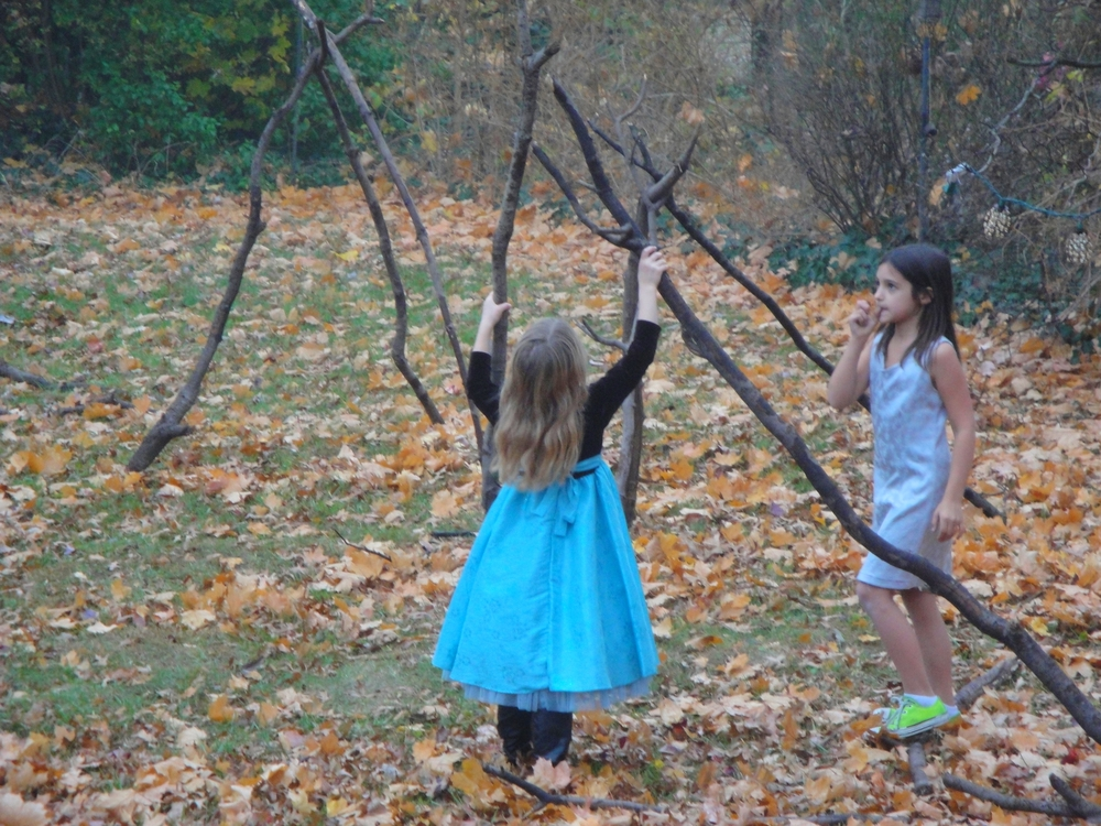 My daughter and her friend, wearing the most beautiful dresses they could find to build teepees in the back yard.