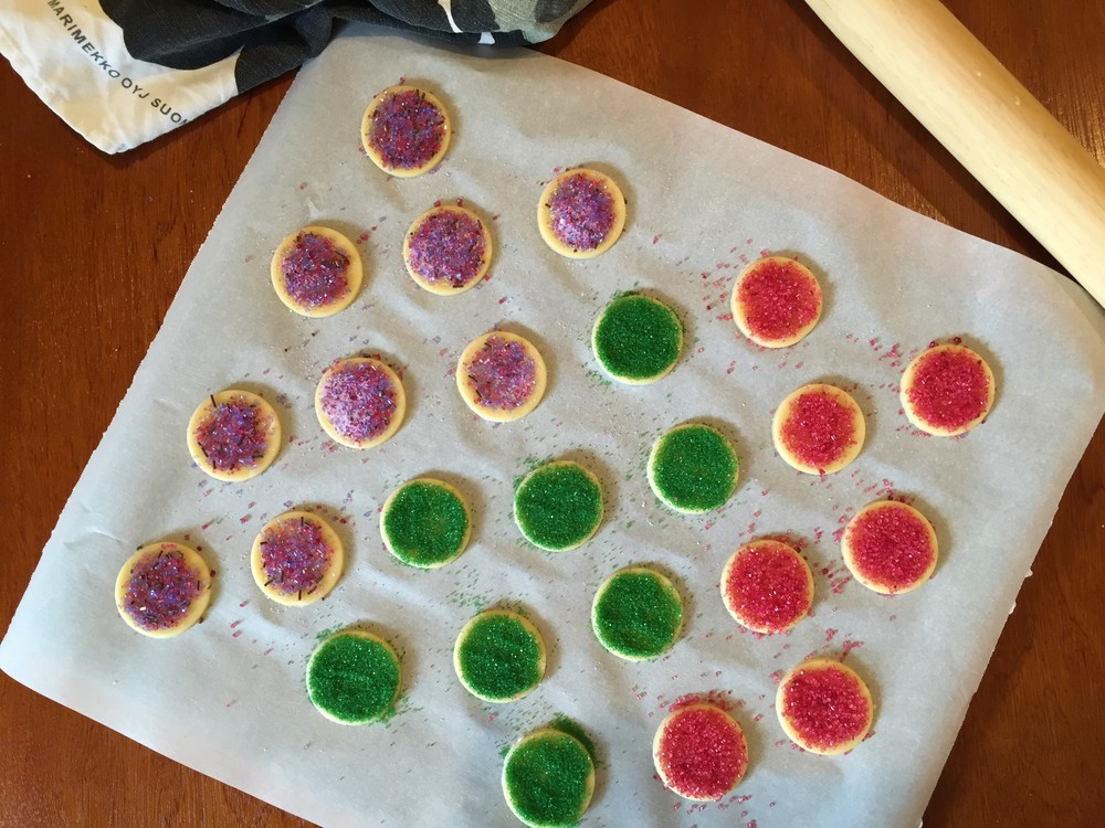 Simplest Cookie-Cutter Cookies topped with colored sugar, ready to go into the oven in the Adventure Kitchen, December 2015.
