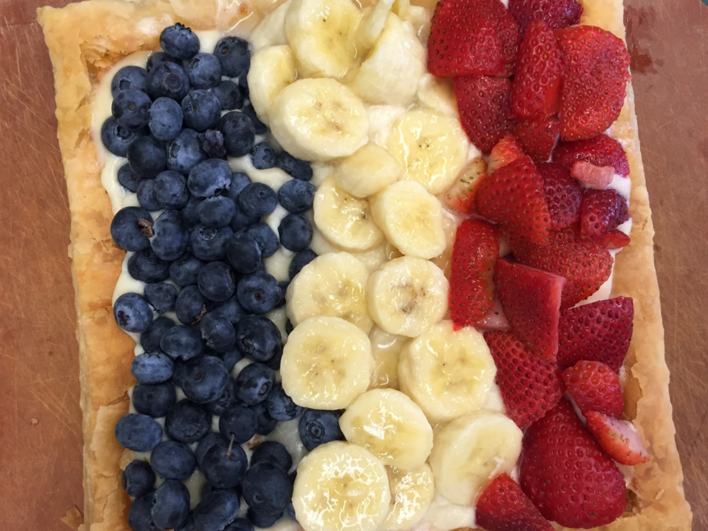 Easy Puff Pastry Tart made in Adventure Kitchen cooking class to evoke the French flag. You can any design that appeals to you, of course!