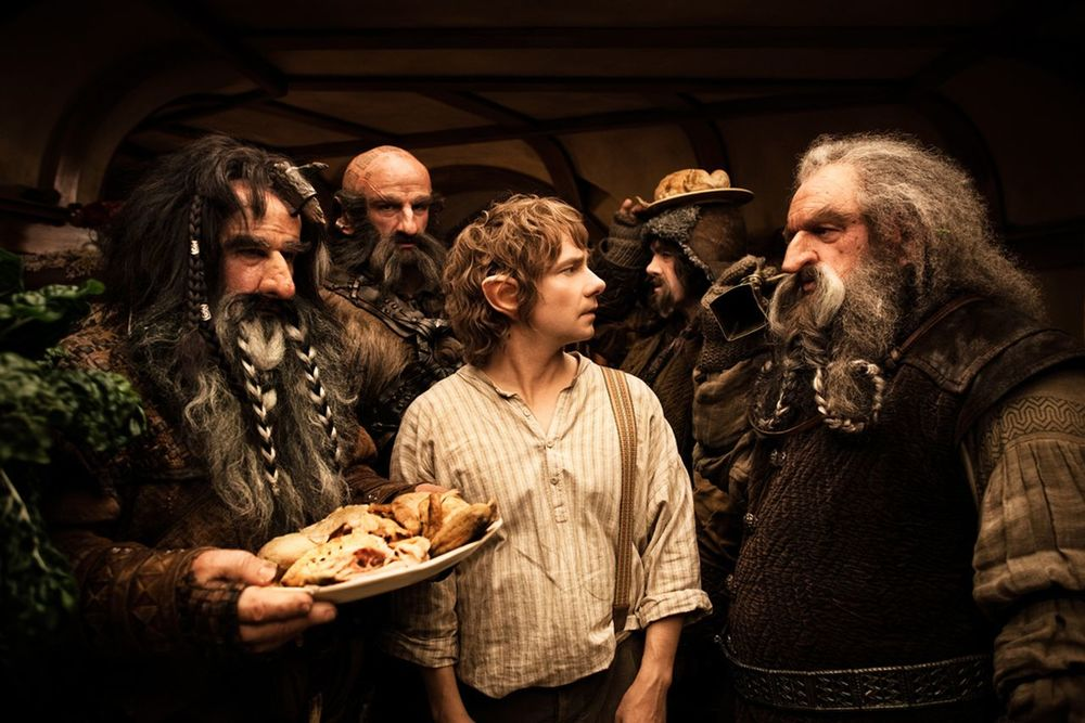 "Bilbo Baggins and the Dwarves with a platter of pasties, from the movie ""The Hobbit"" in 2012, based on JRR Tolkien's classic book. In the book, the Dwarves are famously brilliant miners, so perhaps they have a special Dwarvish pasty tradition?"