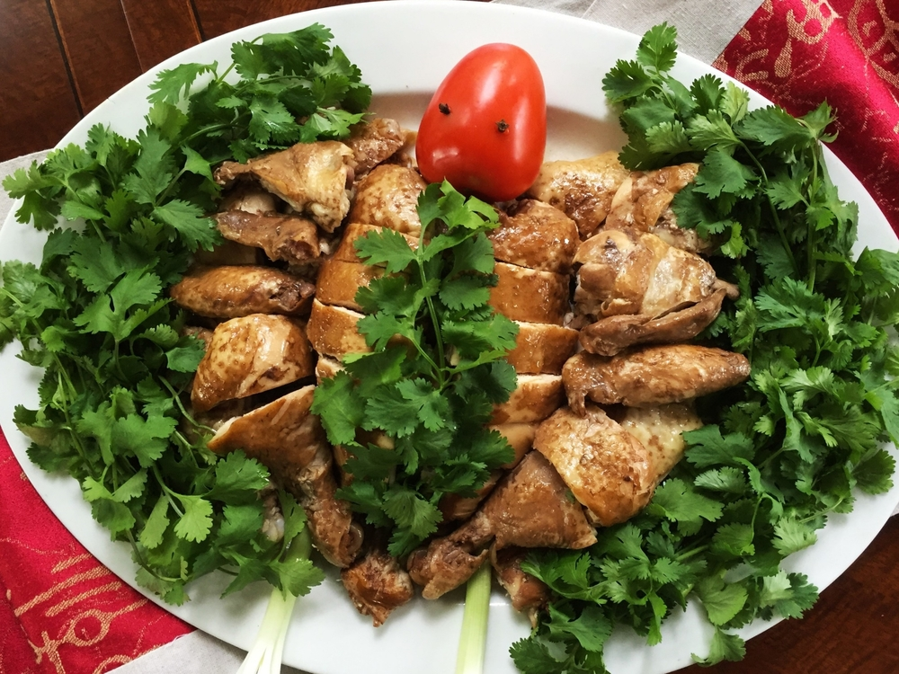 Our final presentation. Note that we used quite a bit of cilantro on top of the breast pieces to disguise the uneven coloration. If you don't have that problem, you may want to use less garnish on top so you can show off your beautiful chicken pieces better.