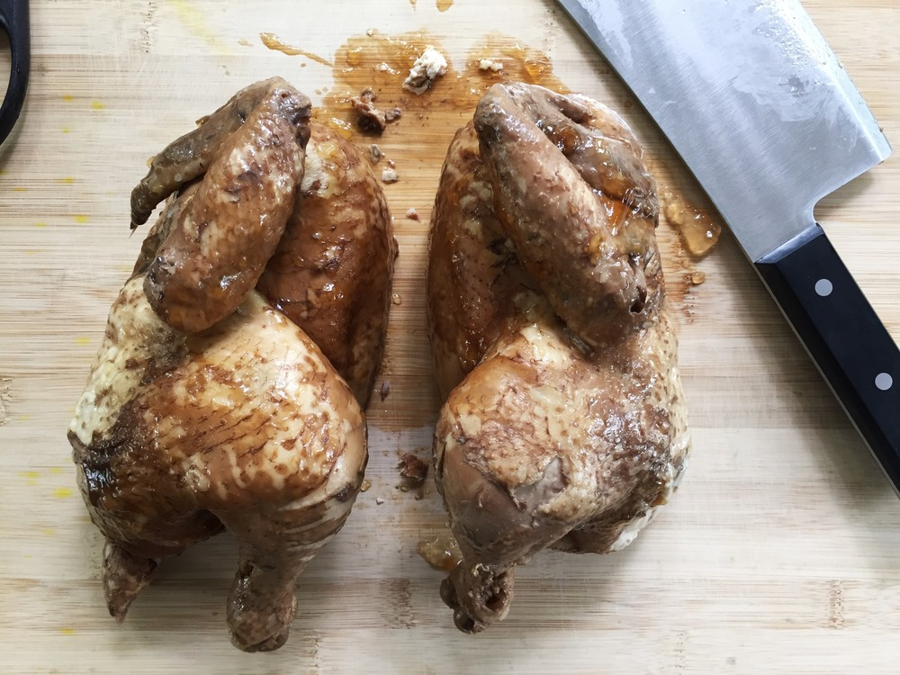 Chicken split into two halves.
