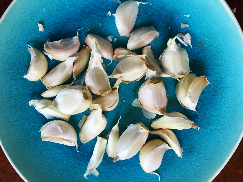 Twenty-four cloves of garlic, unpeeled and ready to be thrown into the pot.