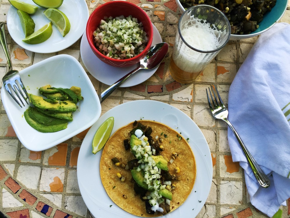 Tacos are ready, served with a cold beer.