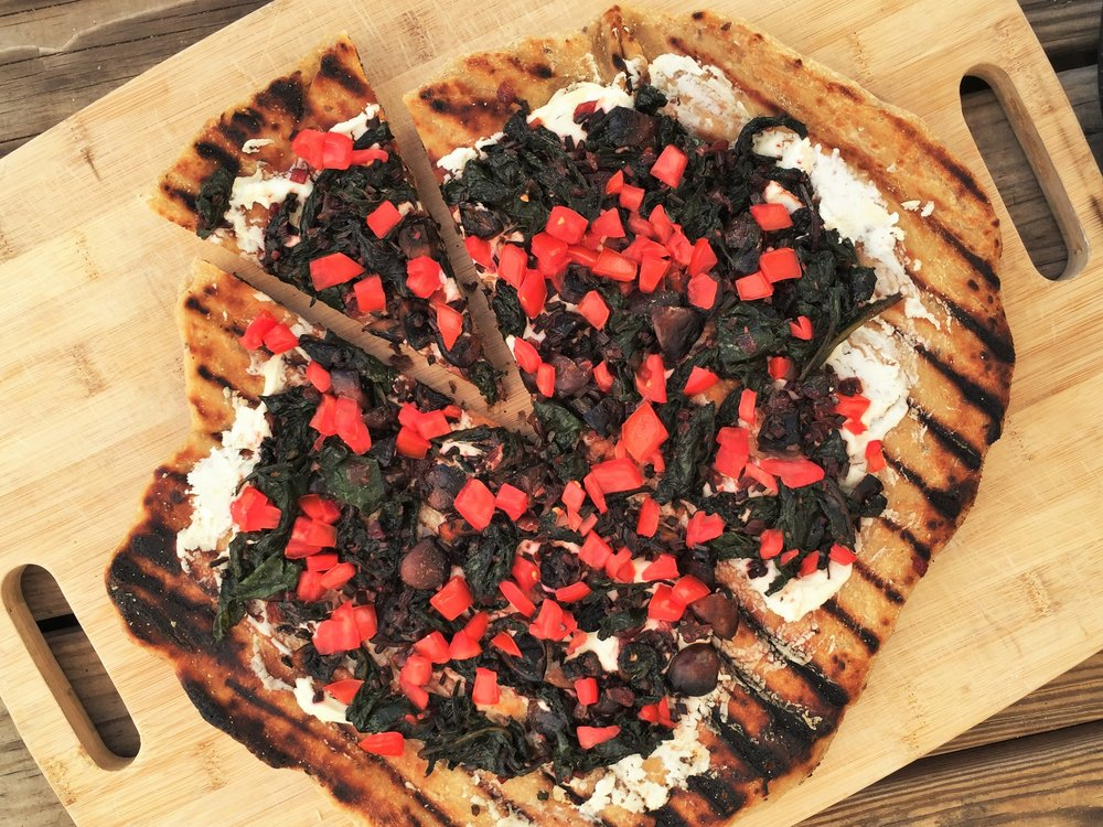 Grilled Pizza with Beet Greens and Goat Cheese made in the Adventure Kitchen with store-bought multigrain pizza dough