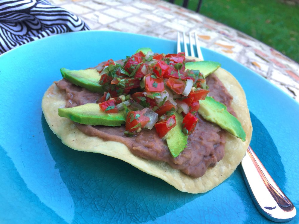 tostada with avocado and pico de gallo