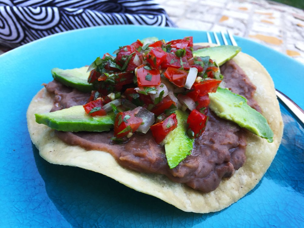 Tostada with pico de gallo and avocados