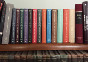 The complete set of A Series of Unfortunate Events on our bookshelf, flanked by just a few of the many, many works that provide literary references for the series.