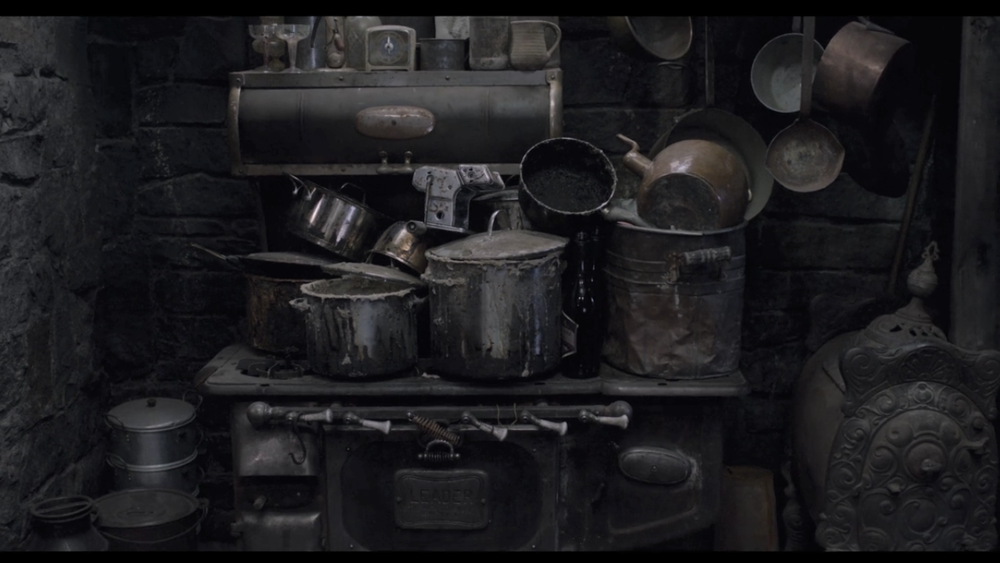 This image was obtained by one of my associates from the files of the Netflix corporation, at great personal risk. Count Olaf's disgusting pots of cold porridge can be seen clearly with the naked eye.