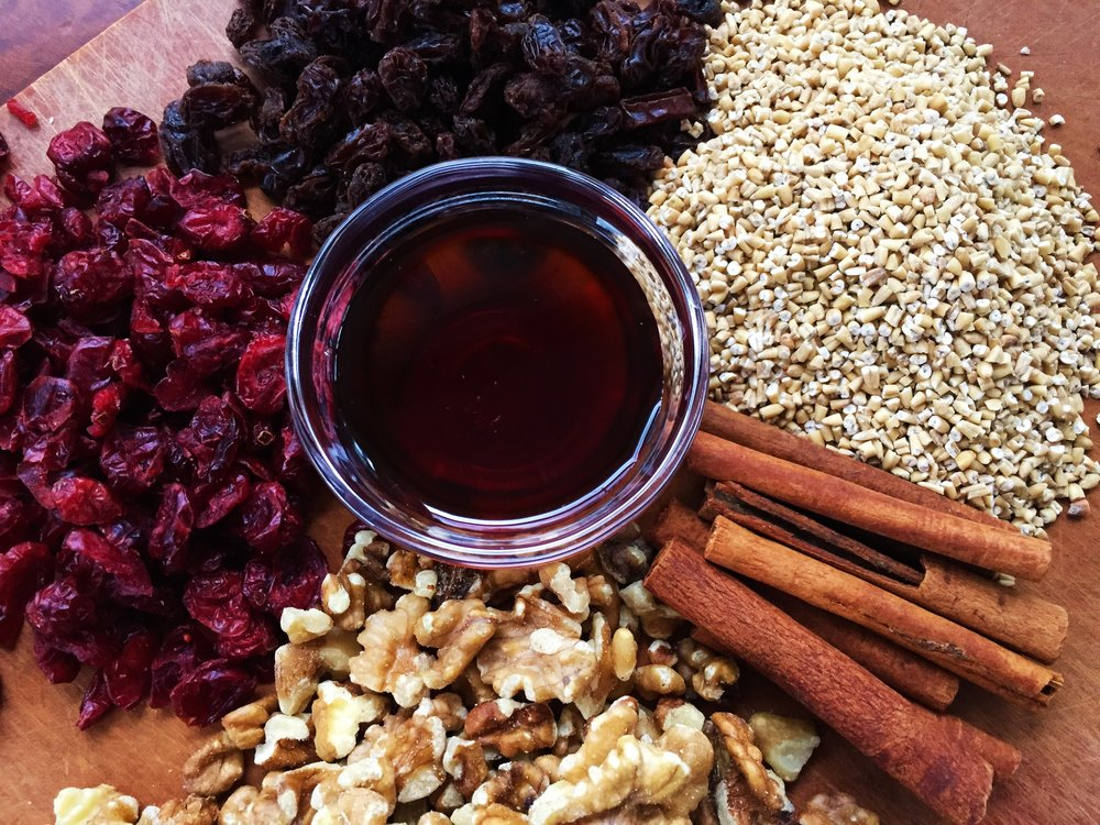 Steel-cut oats, raisins, cranberries, cinnamon sticks, walnuts, maple syrup