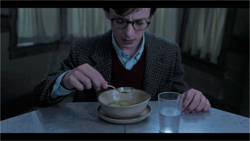 This photograph, possibly taken by a spy from the Netflix corporation, shows Klaus Baudelaire at the very moment before he tasted Aunt Josephine's cucumber soup. For many years afterward, Klaus would wrestle with the question... what if? What if he had never put that spoon to his lips? What if he had somehow managed to figuratively taste the soup rather than literally tasting the soup? What if he had simply gotten up and turned on the stove himself, sparing his siblings the woeful misery of that frightfully frigid meal? If only I could go back in time to this very moment and warn Klaus, perhaps taking that spoon out of his hand myself and confronting Aunt Josephine before it was too late. But that is not how the story goes.