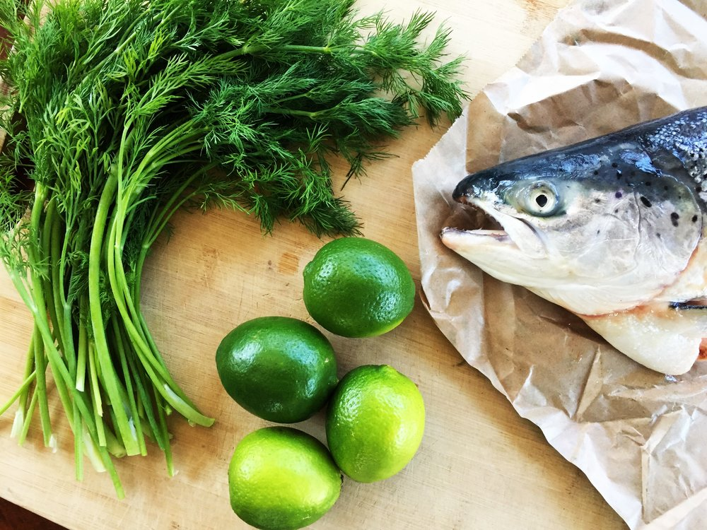 Salmon head, limes and fresh dill