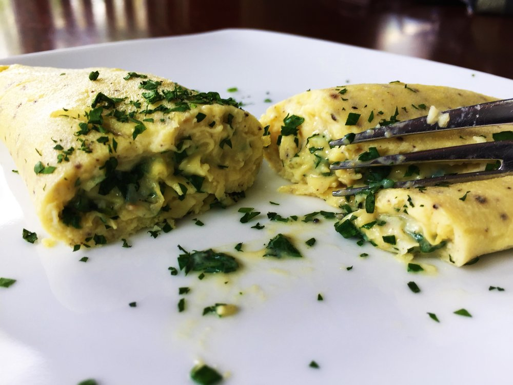 Perfectly cooked omelette - creamy, curdled eggs encased in a light outer shell of cooked eggs, not browned.