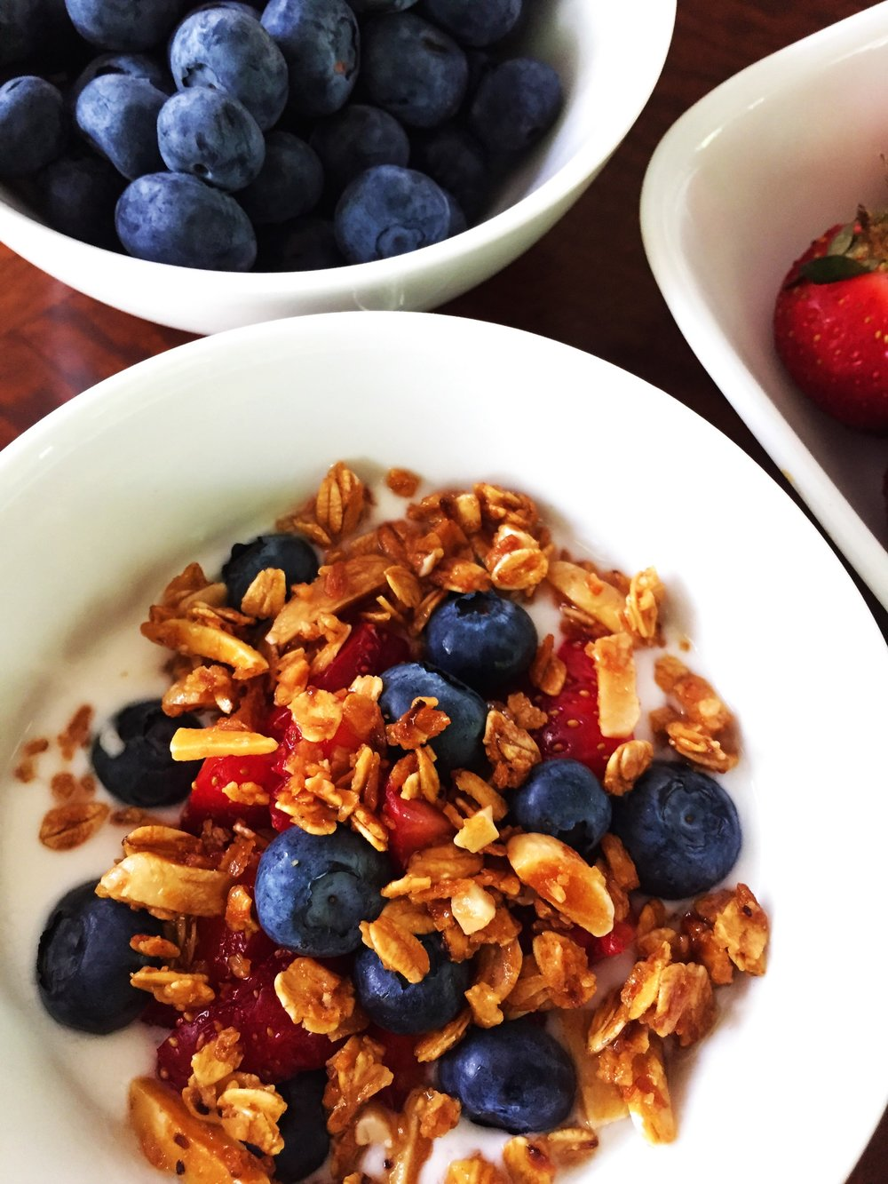 Coconut-Almond Granola over berries and yogurt in the Adventure Kitchen.