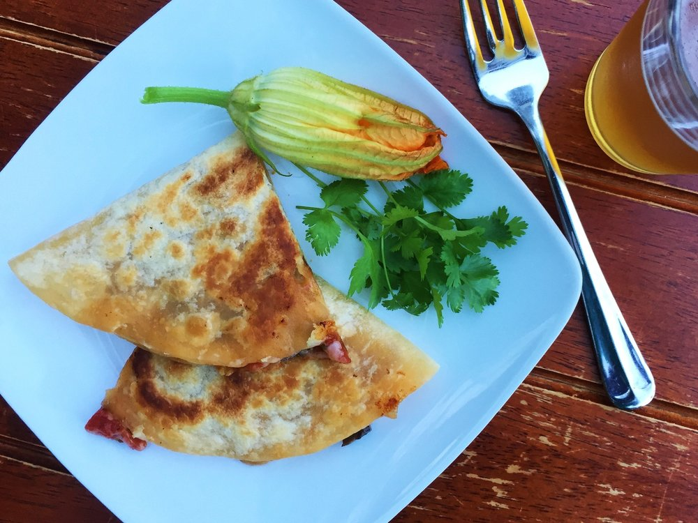 Squash Blossom Quesadilla made in the Adventure Kitchen.