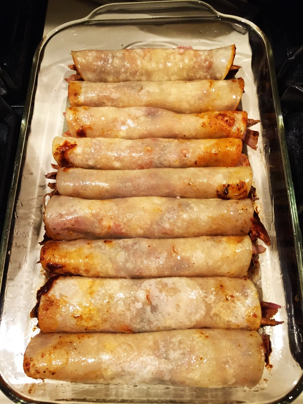 Enchiladas, all rolled up and ready for sauce and cheese.