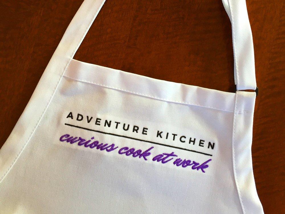 Adventure Kitchen apron - curious cook at work.jpg