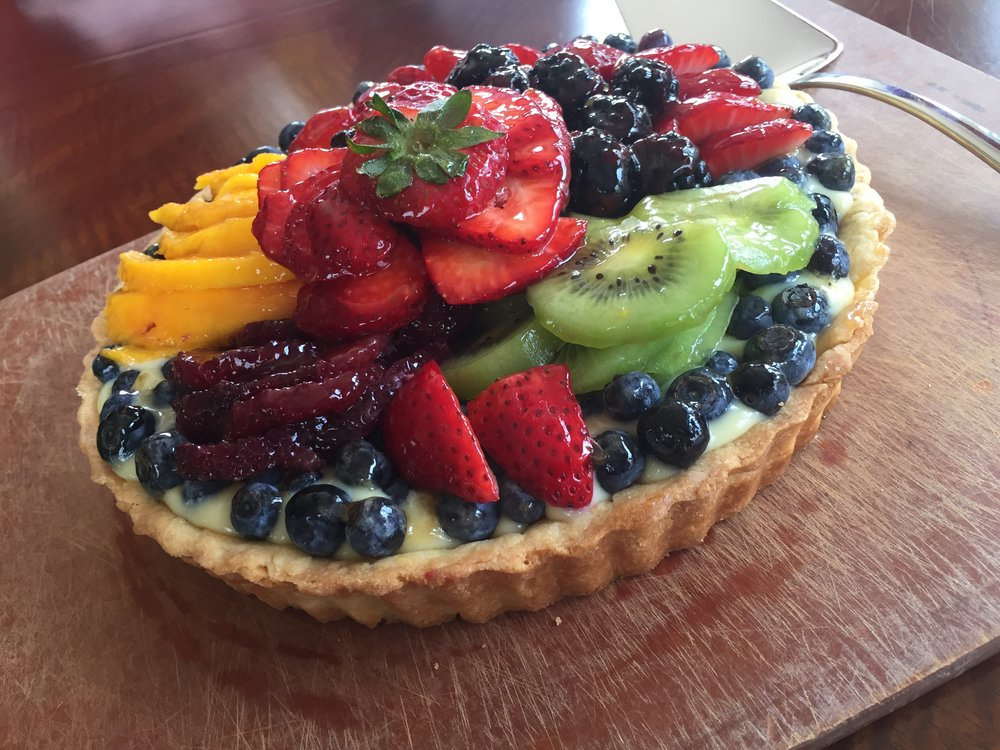 Classic French Fruit Tart made in the Adventure Kitchen with blueberries, strawberries, Ataulfo mangoes, blackberries, blood oranges and kiwi.