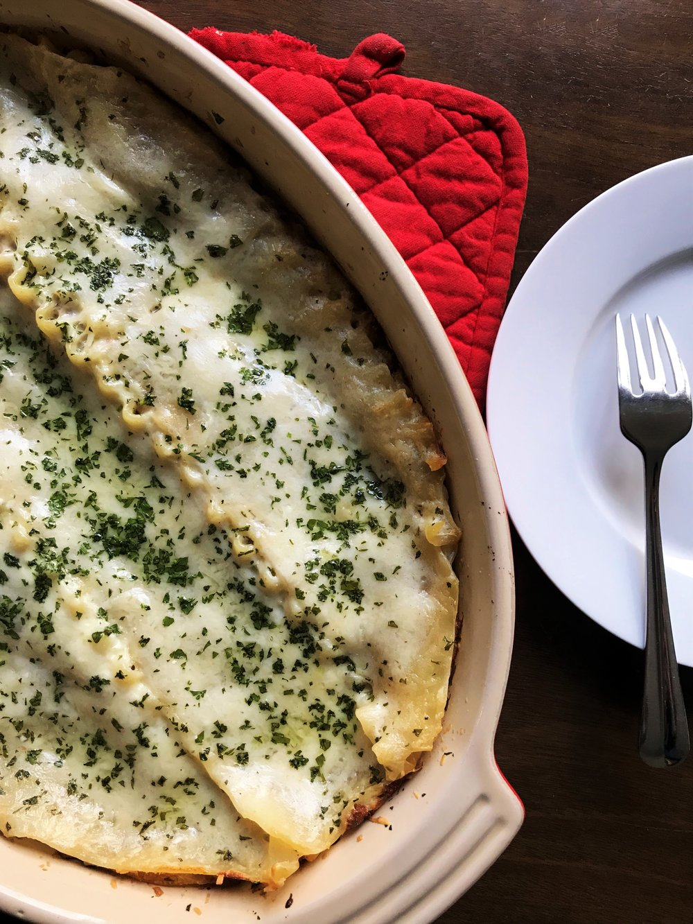 Classic Lasagna, made with Bolognese sauce and Parmesan bechamel in the Adventure Kitchen, with a sprinkle of pecorino Romano and parsley. Plan ahead to make the Bolognese sauce the day before.