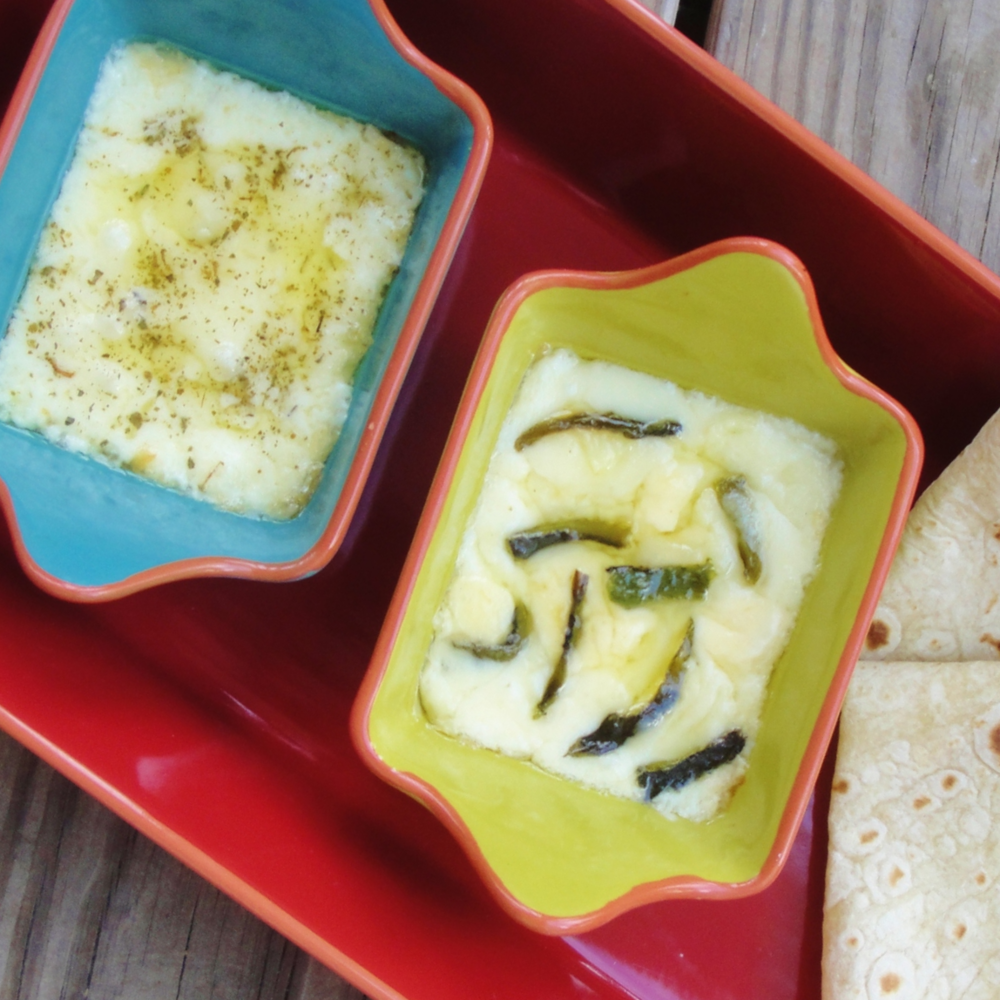 Two mini Queso Fundidos made in the Adventure Kitchen with Chihuahua cheese and Mexican oregano (left) and roasted Poblano chiles (right).