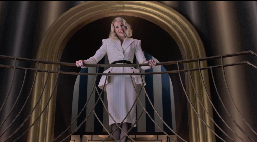 Esme Gigi Geniveve Squalor on the stylish staircase balcony in her penthouse apartment, welcoming us for our exclusive interview. (Photo credit: Netflix staff photographer on loan to The Daily Punctilio)