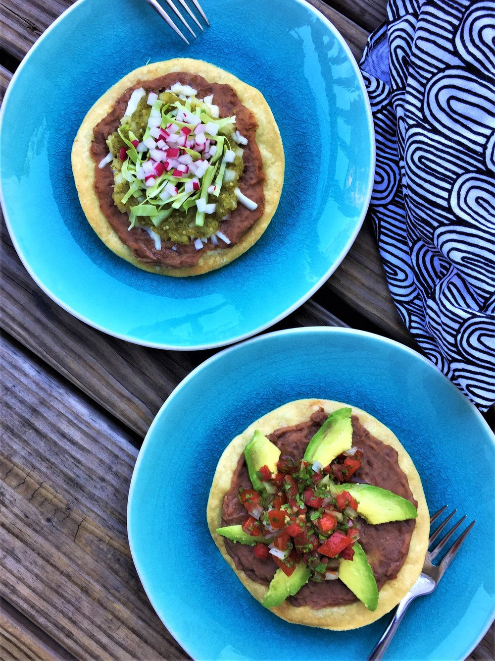 Tostada with Roasted Tomatillo Salsa  (top), and  Tostada with Avocados and Pico de Gallo  in the Adventure Kitchen.