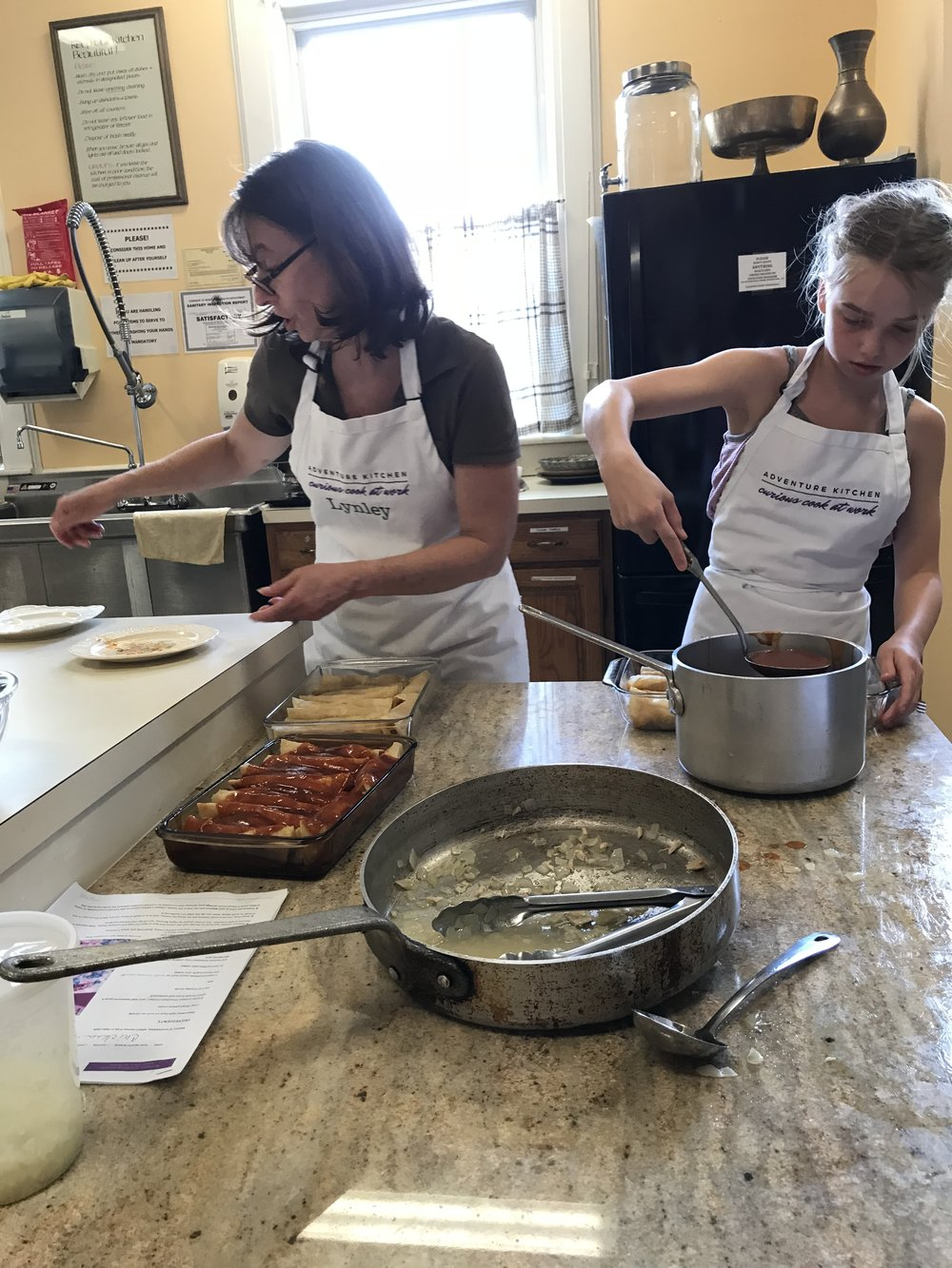 Prepping enchiladas to go into the oven