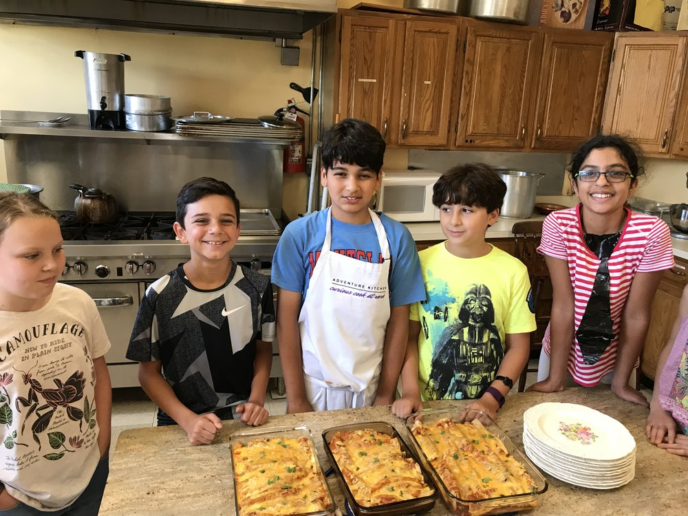 Campers with their Chicken Enchiladas