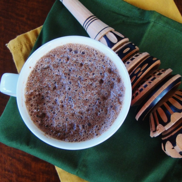 A frothy cup of Mexican hot chocolate, along with my molinillo.