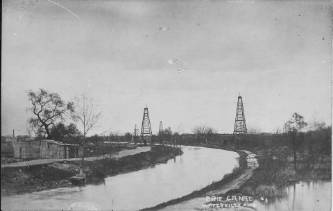 Oil derricks along the canal