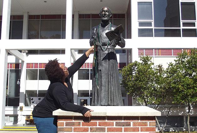 St. Ignatius statue at Loyola University with Mardi Gras beads