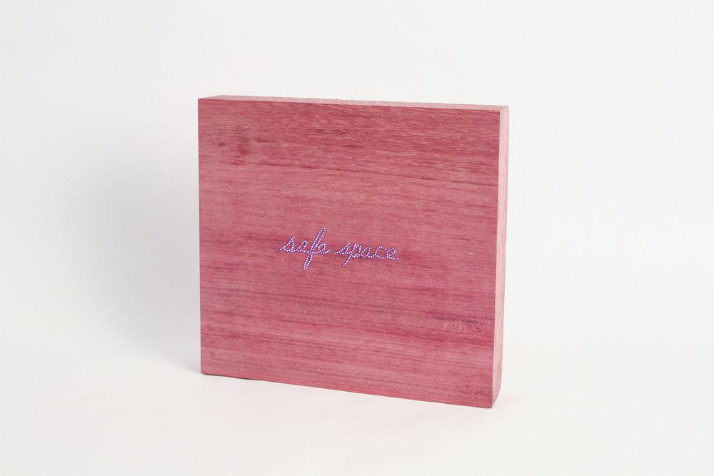 "safe space, 2017. Swarovski crystal on purpleheart wood. 9.75"" x 10.25"" x 2"". Edition of 10."