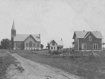 The present church, built on the foundation of the first brick church which was destroyed by fire in 1893.