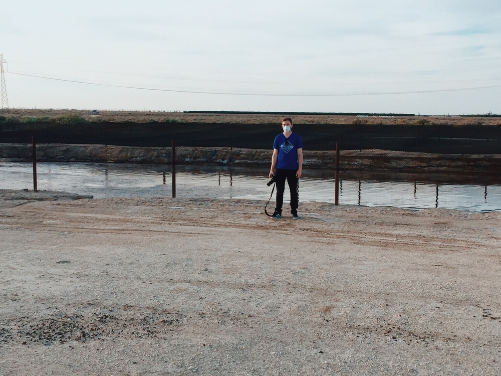 Rosanna snapped this photo of me as I stood beside one of the wastewater pits.