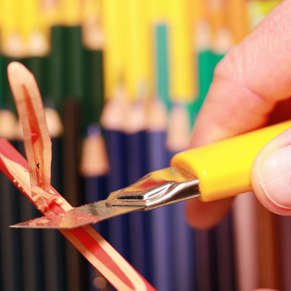 Shaving a colored pencil for use in a piece of jewelry