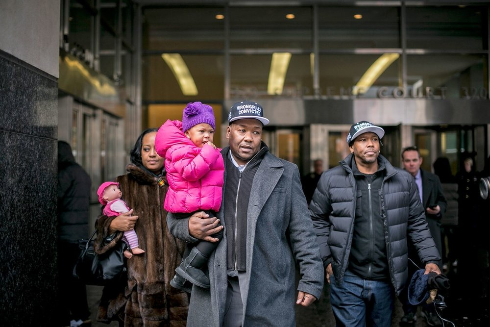 Hamilton after his exoneration, in 2015, with his wife, daughter, and brother.  Photograph by Anthony Lanzilote / The New York Times / Redux