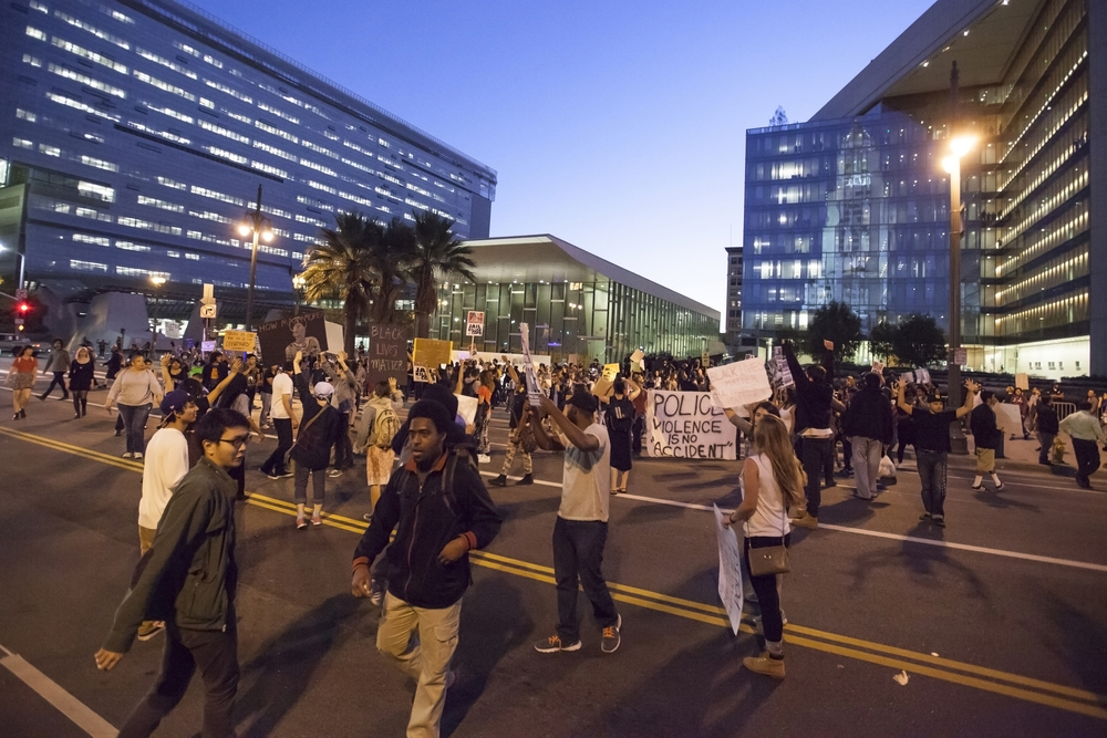 Protesters march in front of LAPD headquarters during a rally in support for Mike Brown on Wednesday Nov. 26, 2014. Mike Brown was shot in Ferguson, Miss. by officer Darren Wilson after a confrontation between the two. Brown's death and officer Wilson's non-indictment sparked a national debate and outrage over the use of deadly force by police. Los Angeles, Calif.